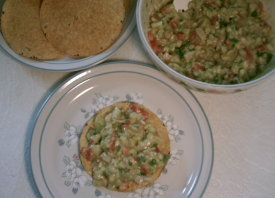 This is a picture of the finished ceviche made from this recipe, served with round tostadas as a meal or appetizer.