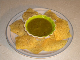 This is a picture of the finished salsa made from this recipe, served complete with tortilla chips as you would typically see as an appetizer in a Mexican restaurant.