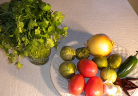 This is a picture of the ingredients that will be used for the recipe to make authentic Mexican Salsa - including .